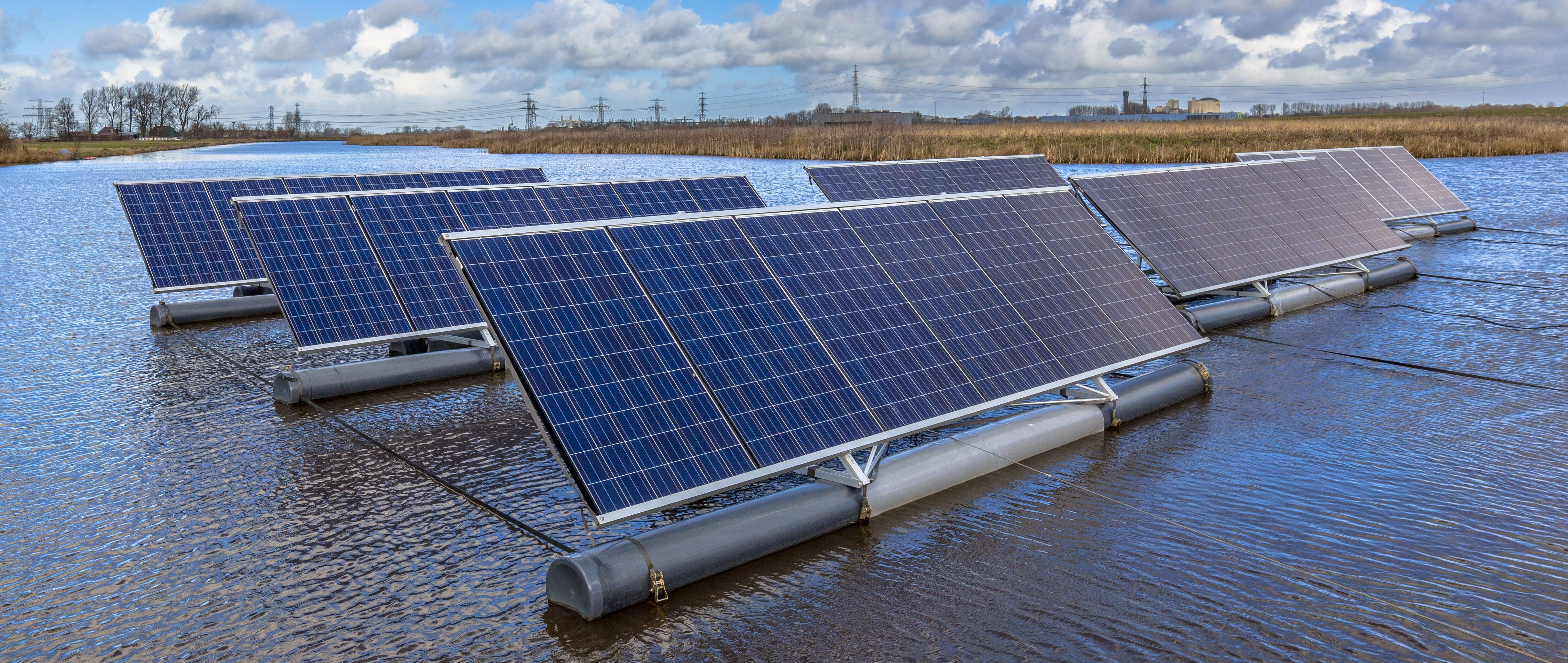 close-up-of-group-of-photovoltaic-panels-floating--PN54BKL.jpg
